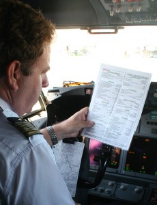 Pilot With Plane-Parking Checklist, cc-by, curimedia.